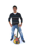 The artist and is guitar. Royalty Free Stock Photos