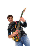 The artist and is guitar. Royalty Free Stock Photo