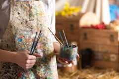 Artist hand holding paintbrush. Closeup of female artist hand holding paintbrush Stock Images