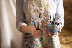 Artist hand holding paintbrush Royalty Free Stock Photography