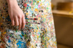 Artist hand holding paintbrush Stock Photos
