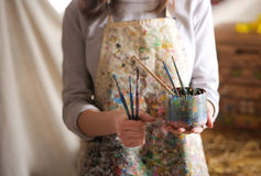 Artist hand holding paintbrush Stock Photo