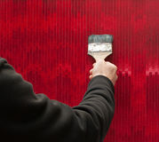 Artist hand and red painting. With brush Stock Photography