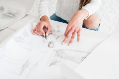 Artist hands drawing sketch on whatman. Or white paper. Female painter painting in studio. Stylish woman with mehendi oh hand working in workshop. Art, talent Royalty Free Stock Photo
