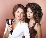 Artist. Healthy hair. Makeup. Two Beautiful brunette girls with Stock Photography