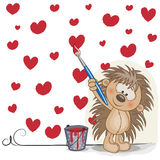 Artist Hedgehog. Cute Hedgehog with brush is drawing hearts Stock Photos