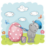 Artist Hippo. Cute Hippo with brush is colored an egg Royalty Free Stock Photo