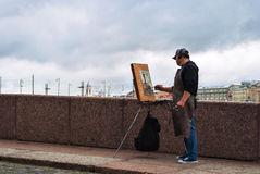 The artist with his easel. Royalty Free Stock Images