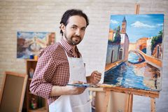 Artist and his masterpiece stock photo