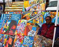 Artist and his work. Artist selling his paintings outside Eastern Market, a public market housed in a 19th century brick building in the Capitol Hill Stock Images