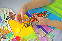 Artist holding brushes, artistic material royalty free stock photo