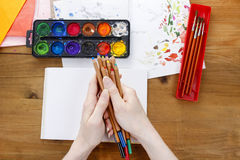 Artist holding colorful crayons in her hands Stock Images