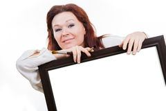 Artist holds empty frame Royalty Free Stock Photo