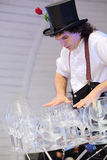 Artist holds lot of glasses on stage Royalty Free Stock Photos