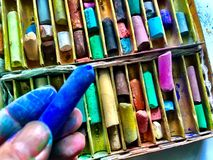 Artist holds pastel stick Stock Images