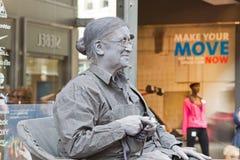 Artist imagines old woman during world championships living statues in Arnhem. Arnhem, Netherlands - September 28, 2014: Artist imagines old woman during world royalty free stock photo