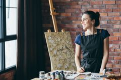 Artist inspiration contemplation woman painter art. Artist inspiration. Dreaming contemplation. Smiling woman painter looking at window. Canvas on easel. Art royalty free stock photos