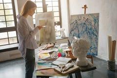 Artist internet blogger taking photos of work. Workshop inspiration mood stock images