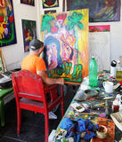Artist Jose Fuster in his Studio. Cuban artist Jose Fuster painting in his Royalty Free Stock Images