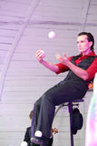 Artist juggling balls on stage Royalty Free Stock Photos