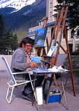 Artist by Lake Louise, Canada. Royalty Free Stock Photo