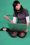 Artist with laptop and brush. Stock Images