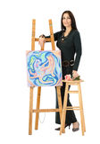 Artist leaning on an easel with abstract painting Cats Stock Photography