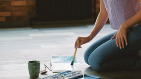 Artist lifestyle create watercolor artwork floor stock footage