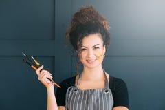 Artist lifestyle portrait lady set paintbrushes stock images