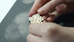 An artist looks at grinded wooden craft on sandpaper.  stock video