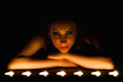 Artist low light show of a beutiful girl in candle stock images