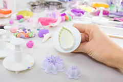 Artist makes jewelry from polymer clay, process. Workshop Royalty Free Stock Images