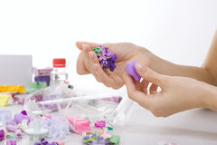 Artist makes jewelry from polymer clay, process. Workshop Royalty Free Stock Photography