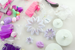 Artist makes jewelry from polymer clay, process. Workshop Royalty Free Stock Photos