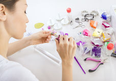 Artist makes jewelry from polymer clay, process. Workshop Stock Photos
