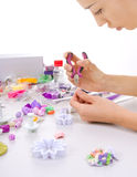 Artist makes jewelry from polymer clay, process. Workshop Stock Images