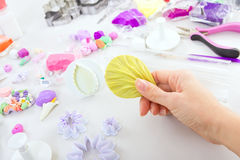 Artist makes jewelry from polymer clay, process. Workshop Stock Photo