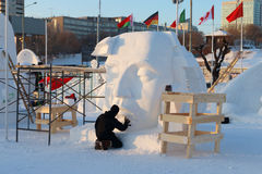 Artist makes sculpture Big face in Ice town Stock Images