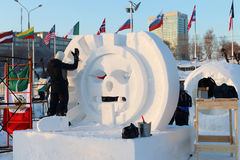Artist makes sculpture Big sun Stock Images