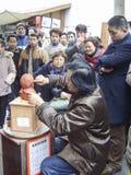 Artist making clay figure in kuanzhai alley,chengdu,china Stock Photo