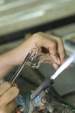 Artist making a glass bird Stock Images