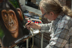 Artist making an painting. Royalty Free Stock Photography