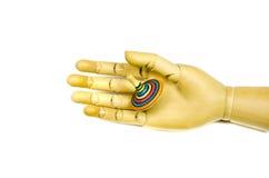 Artist manikin hand holding toy whirligig isolated on white royalty free stock images