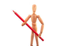 Artist Mannequin. Wooden artist mannequin holding a red colored pencil Royalty Free Stock Photo