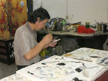 Artist Manufacturing a Chinese Table Decorative Piece Royalty Free Stock Image