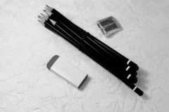 Artist material set with pencils, eraser and sharpener royalty free stock photography