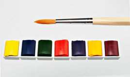Artist materials -  paints and brush over white Royalty Free Stock Photo