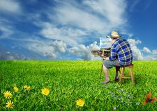 Artist on meadow Royalty Free Stock Images