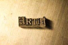 Artist - Metal letterpress lettering sign. Lead metal  typography text on wooden background Stock Image