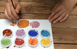 Artist mixing colorful paints Stock Photo